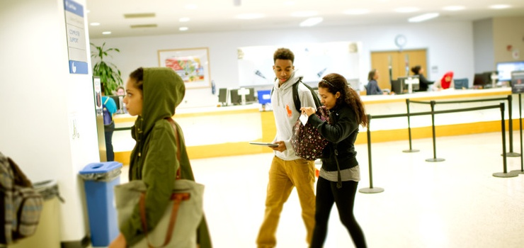 Photo of students walking through the library